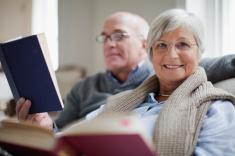 smiling-older-couple-reading-books